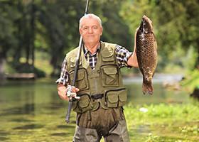 Man Fishing Near an RV Park