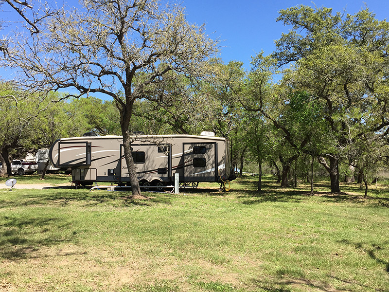 RV Parked Amongst Trees At Our RV Park In San Antonio